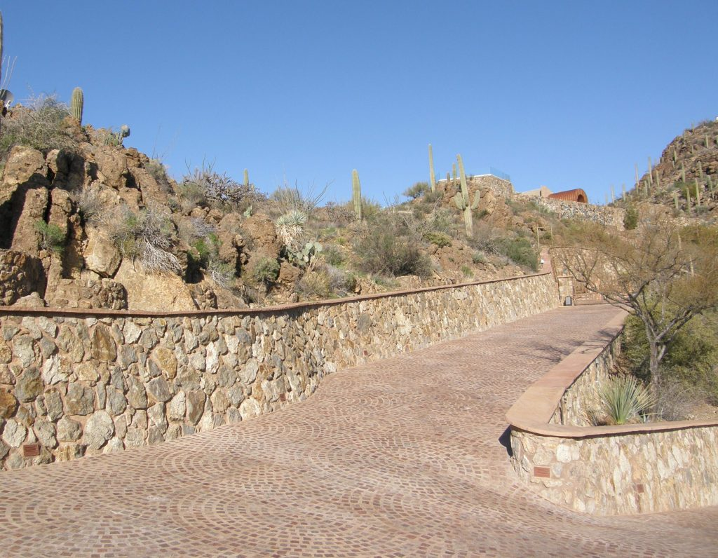 Porphyry Pavers set in overlapping fans create a beautiful and functional design for a steep driveway in Arizona