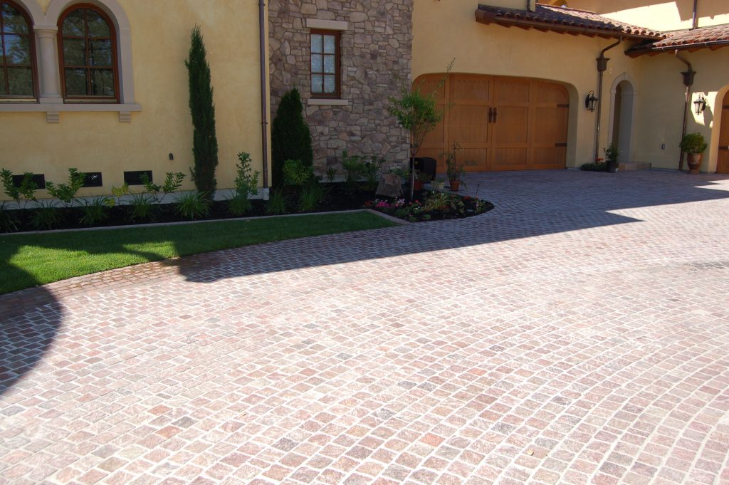 Alamo, CA. Copper Mt Porphyry Driveway. The finished entranceway leading to the garage.