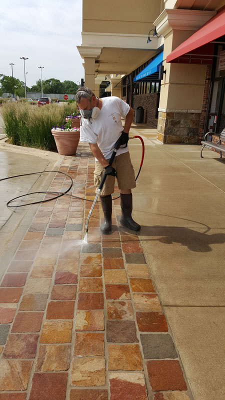 Maintenance crew power washing the new GftK jointing mortar
